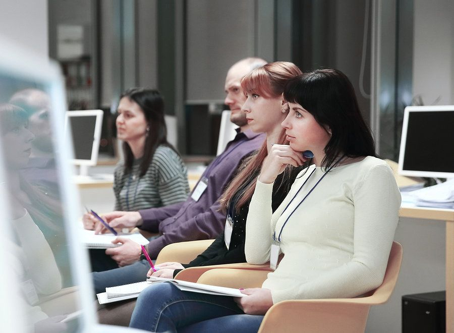 Curious professional attends training about new office technology