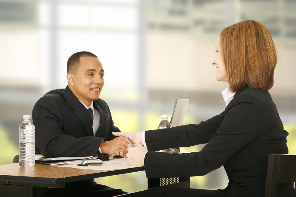 Two professionals conducting an informational interview