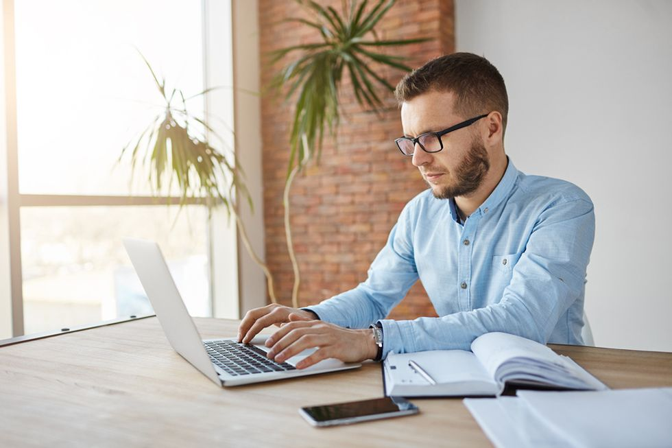 Man crafting cover letter for recruiter
