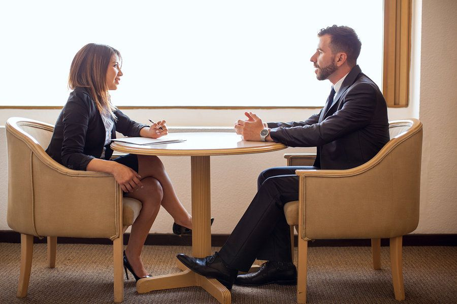 Man interviewing for job with recruiter