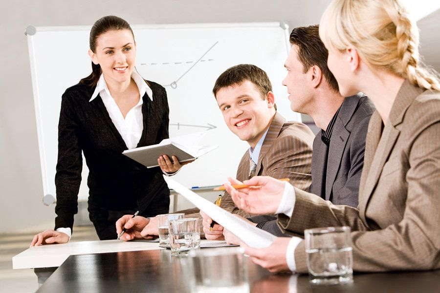 Young professional networks with a group of her peers