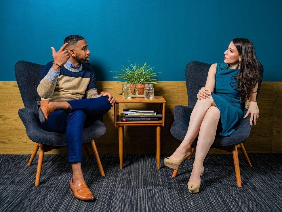 https://www.pexels.com/photo/woman-wearing-teal-dress-sitting-on-chair-talking-to-man-2422280/