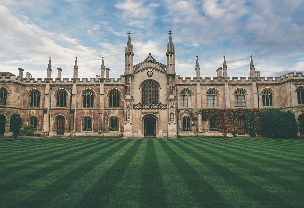 Grass, old college building, blue sky