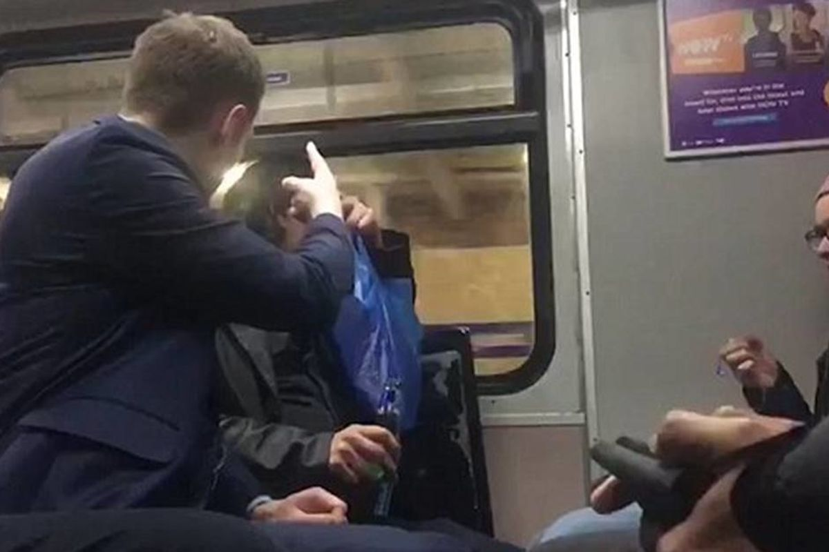 A drunk man was filmed harassing an immigrant on their train ride. The woman next to him responded in the most British way.