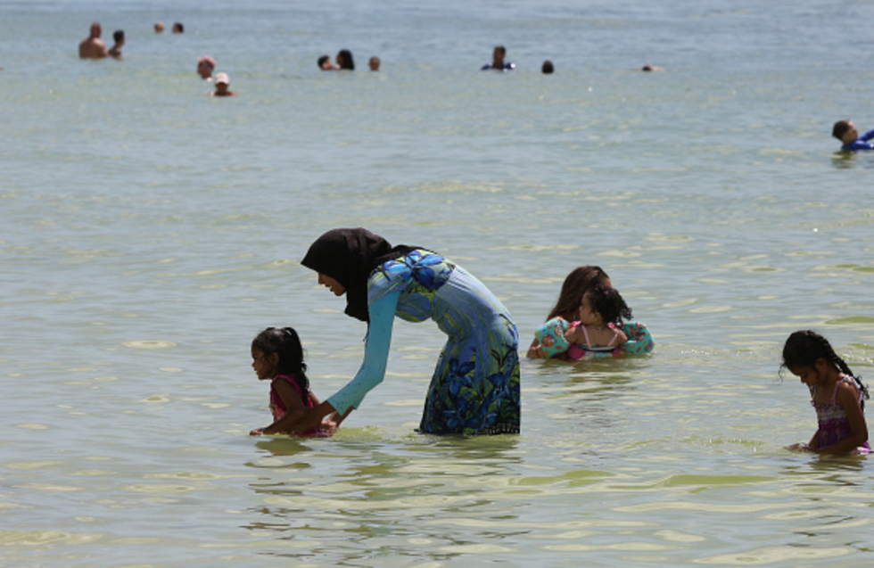 Muslim women protest burkini ban in France swimming pool