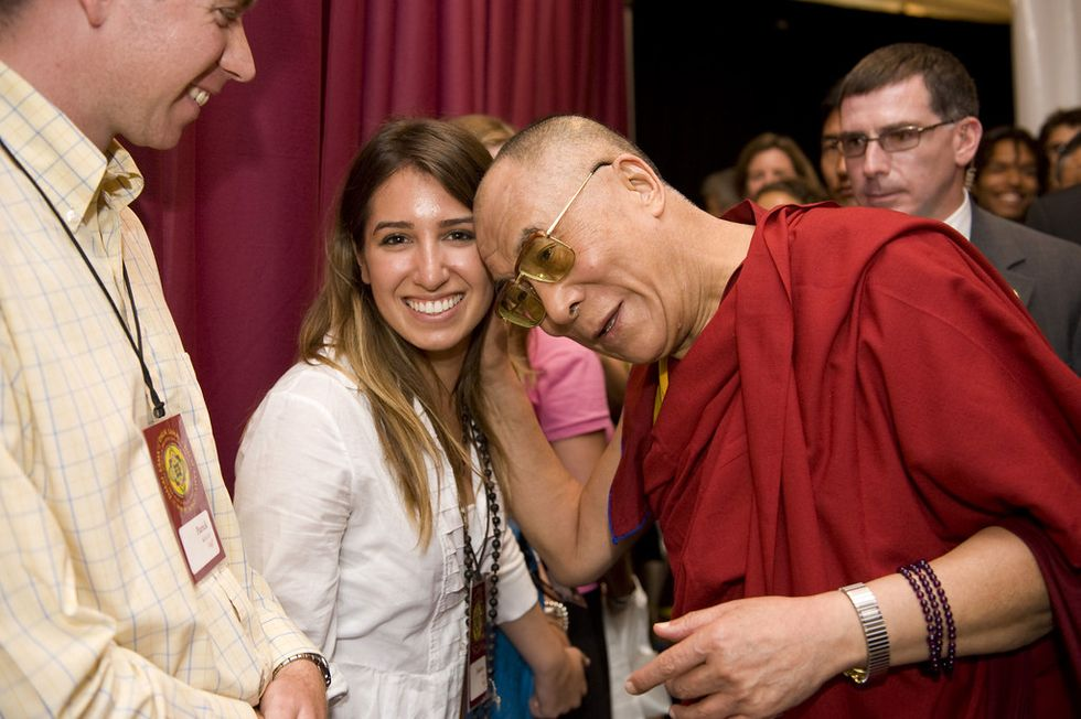 The Dalai Lama is 'deeply sorry' for saying a female successor should be attractive