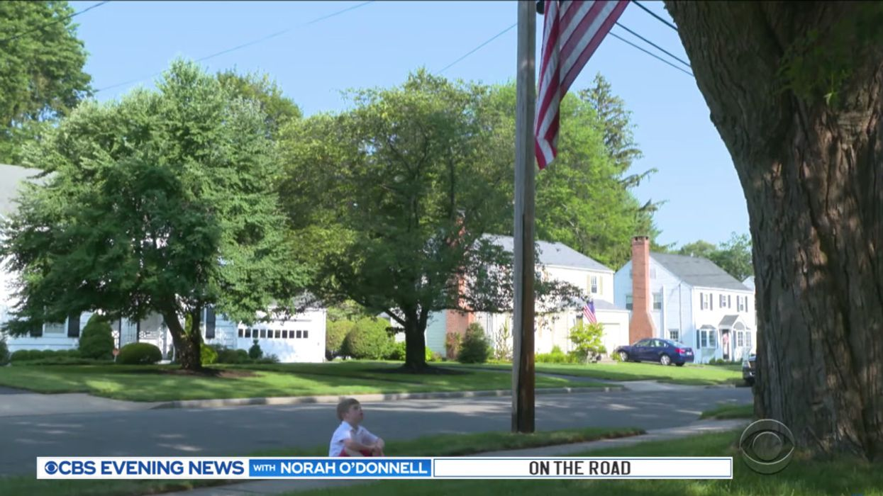 A Connecticut boy with Down syndrome and autism loves the American flag, so his neighbor went out of his way to make sure he could enjoy it every day