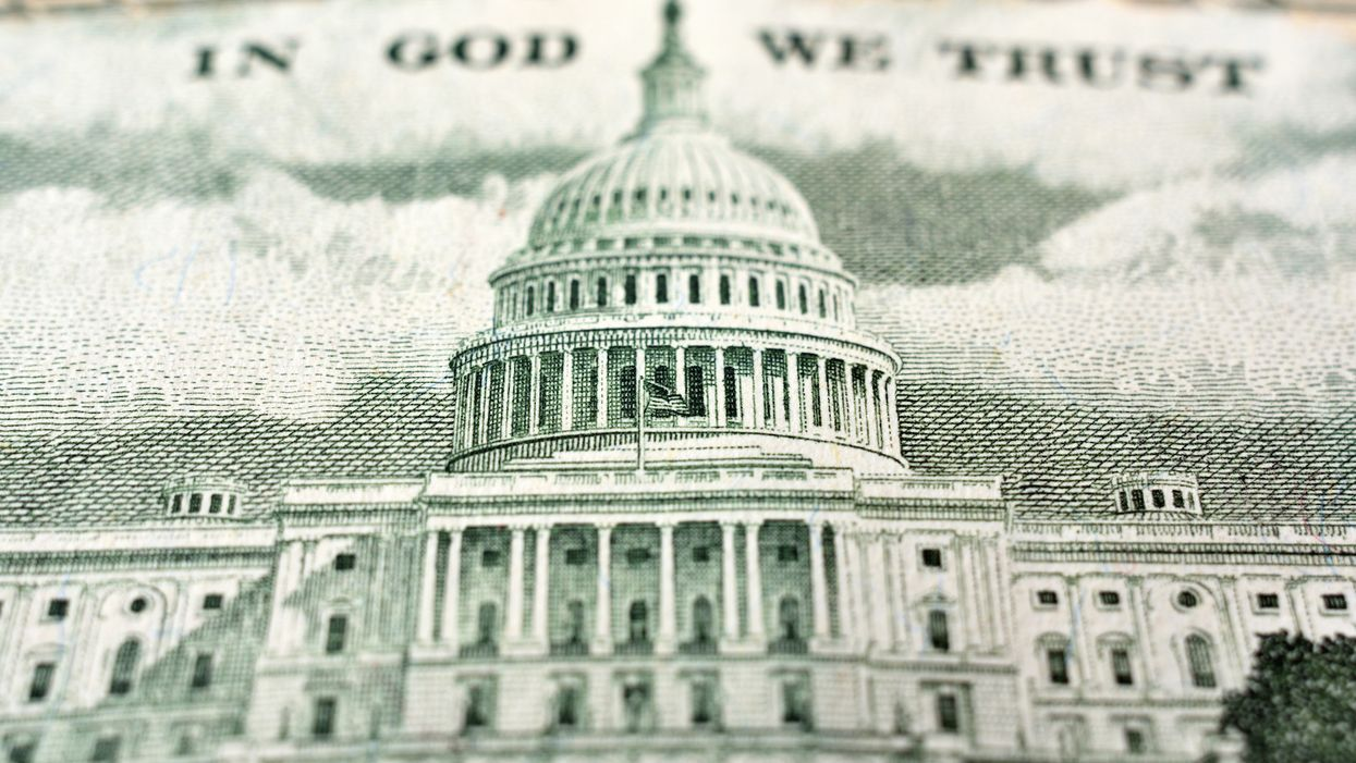 Federal government report says US deficit to grow by $800 billion more than previously expected over next decade, predicts $1 trillion shortfall next year alone
