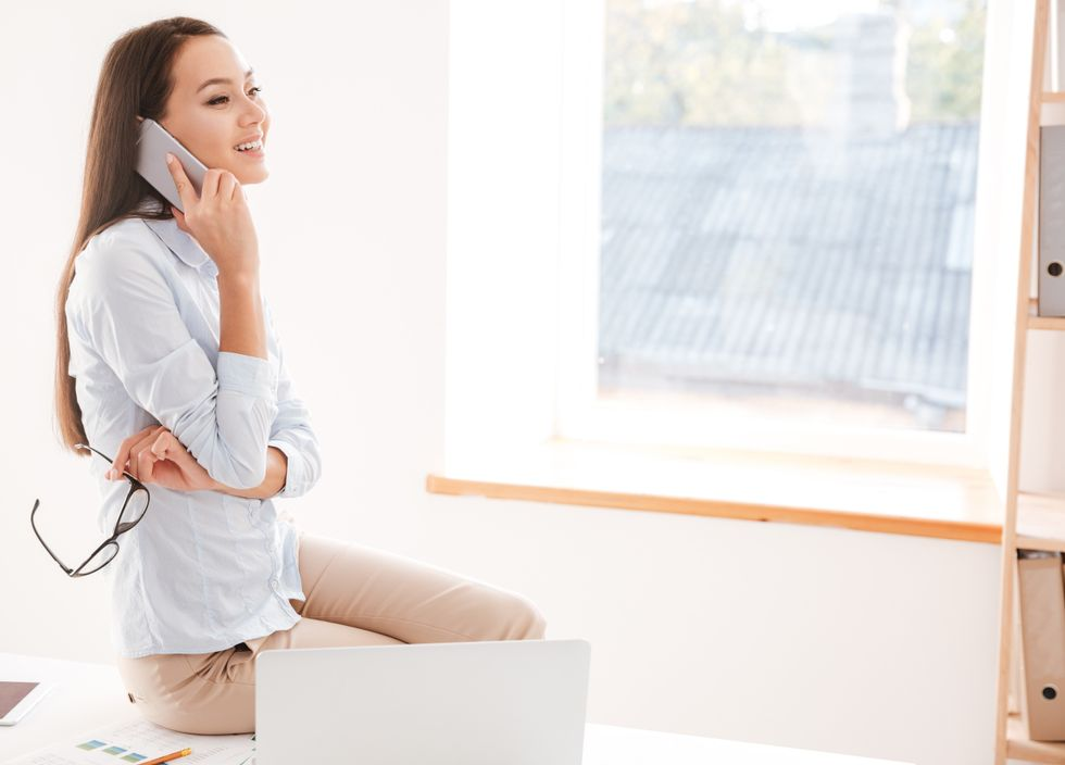 Professional woman asking questions during phone interview