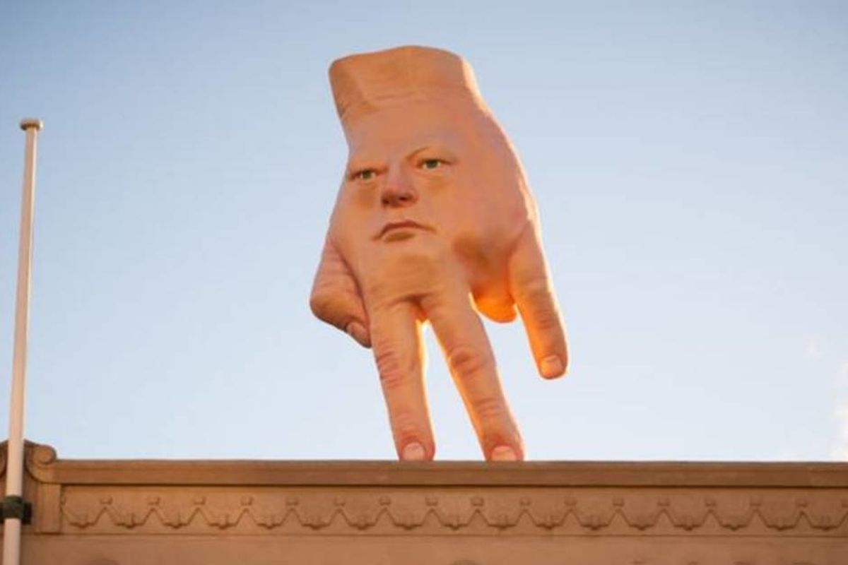 A 16-foot hand-face statue overlooking Christchurch, New Zealand is impossible to ignore