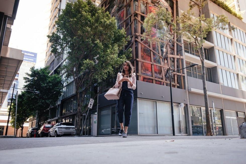 girl walking alone in a city