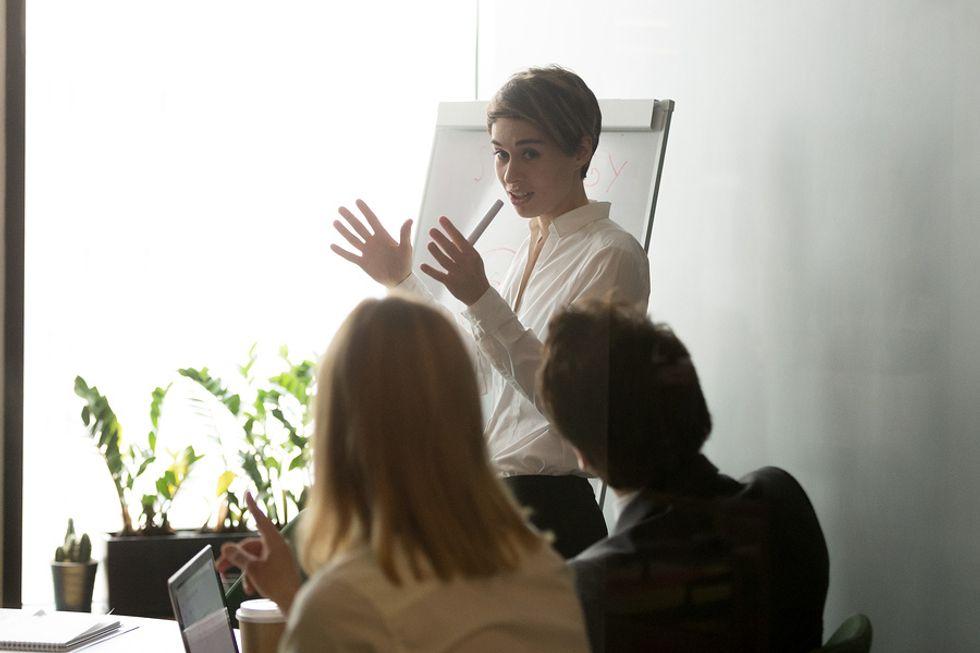 Female boss using her leadership skills at a work meeting.