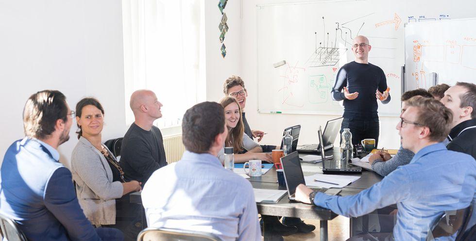 Man using his leadership skills during group presentation.