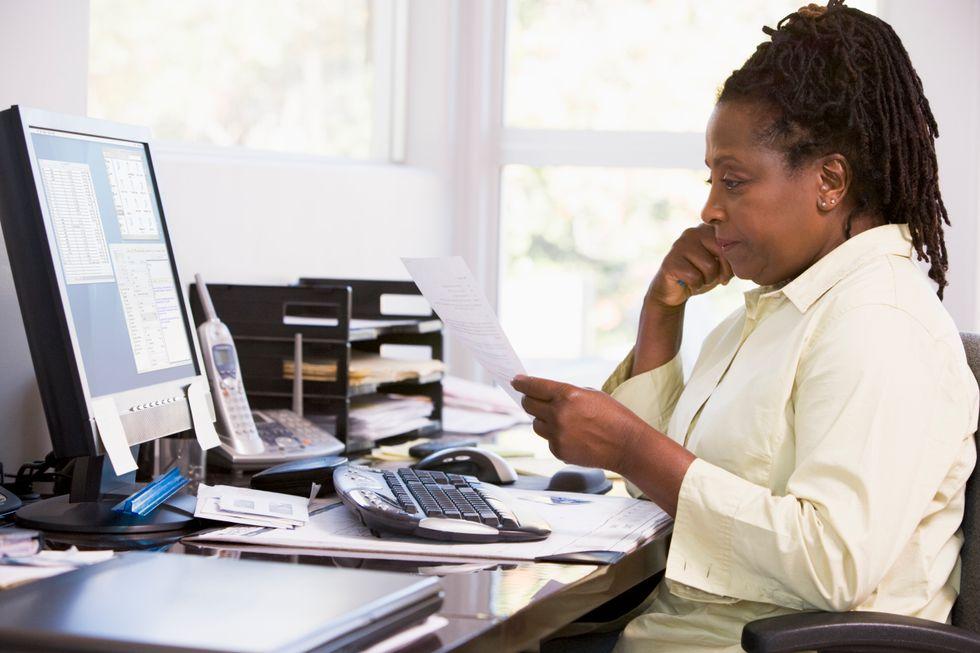 Hiring manager looking over resume explaining job gap