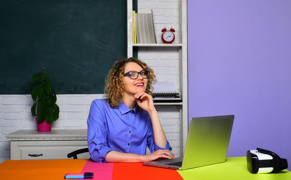 Teacher knowing her job is safe in a recession