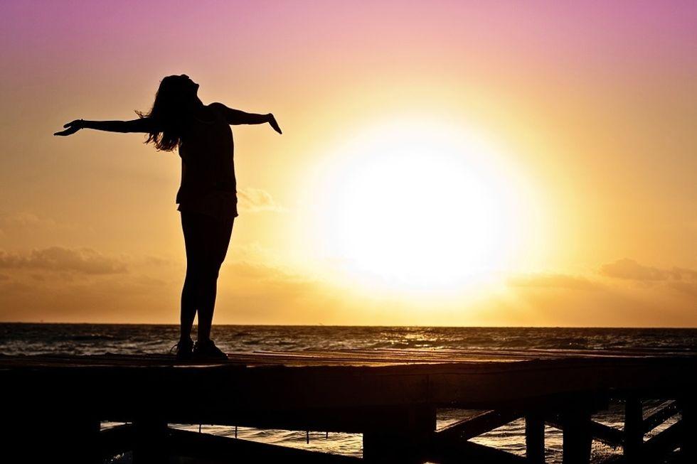 https://pixabay.com/photos/woman-girl-freedom-happy-sun-591576/