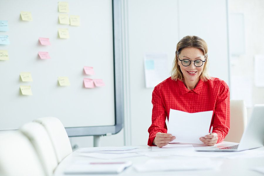 Employer reads an executive resume that aligns with their needs