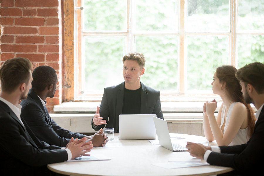 Man sharpening his leadership skills by delegating work to his team at work.