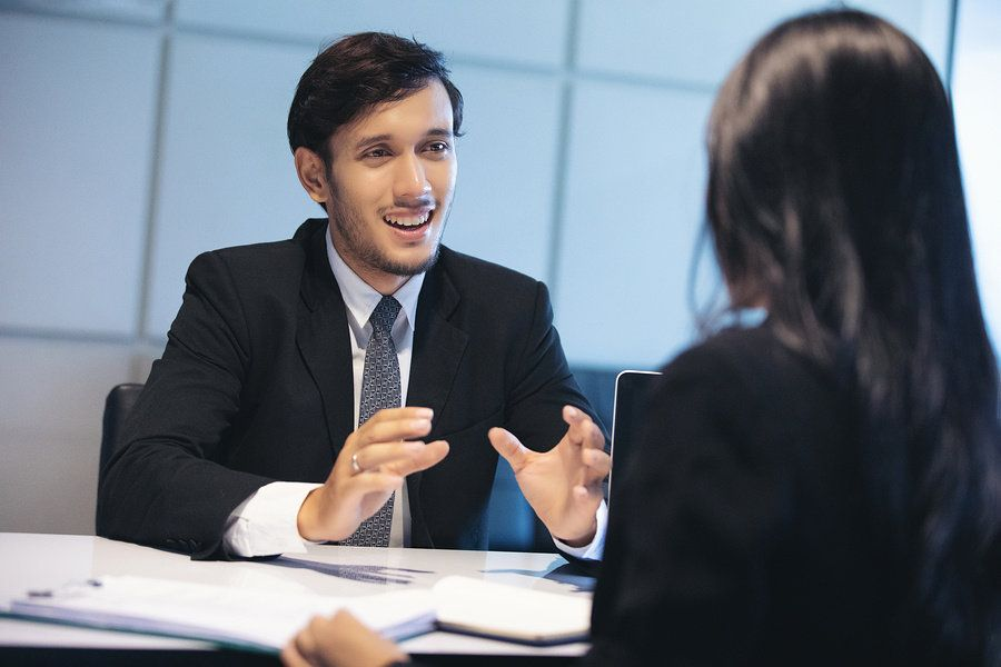 Professional man answers behavioral questions during a job interview