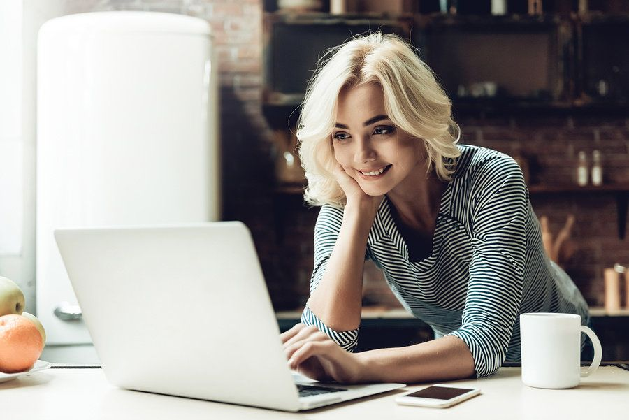 Young woman blogs about her industry in order to stay relevant during a career gap.