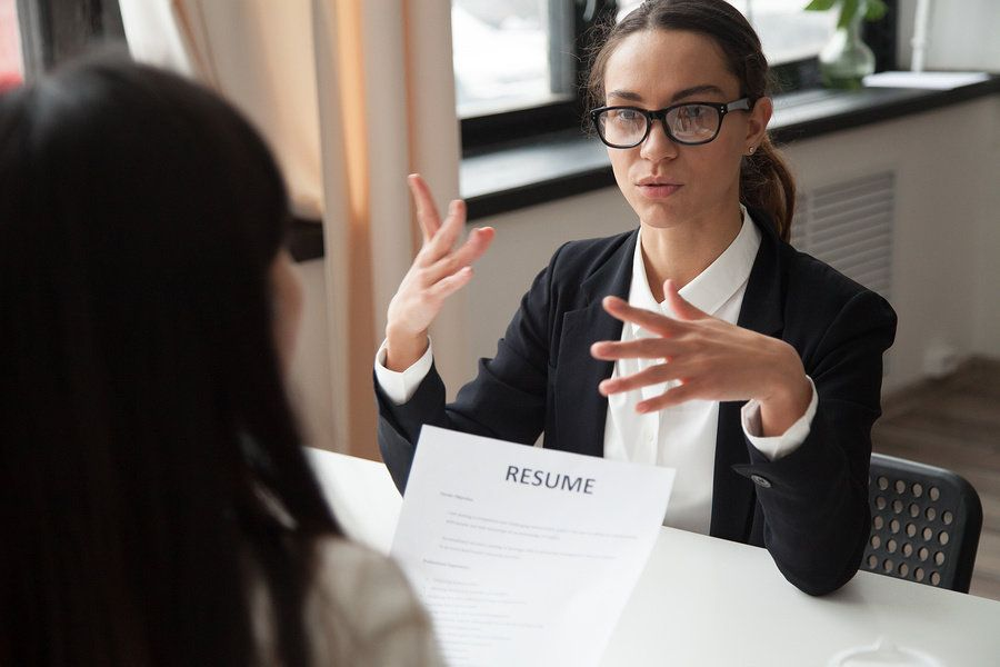 Professional woman answers behavioral interview questions during a job interview