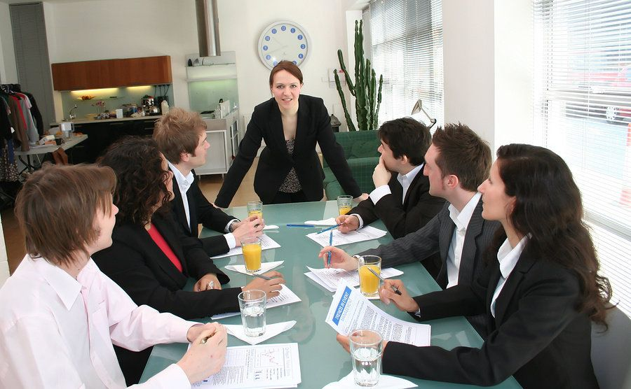 Female boss striving to push the envelope at work and displaying her leadership skills at a work meeting.
