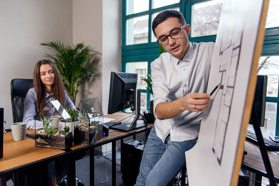 Man showing he's ready to take on more responsibility at work by leading a tough project.