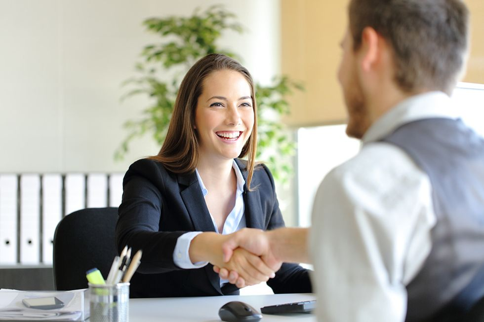 Professional woman successfully conveys her personal brand in a job interview