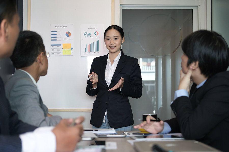Female leader using her personal leadership skills to lead a work meeting.