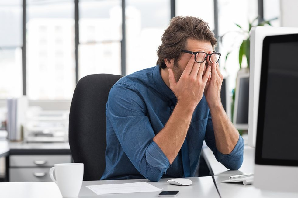 Man upset about the news he just lost his job and now isn't sure what to do.