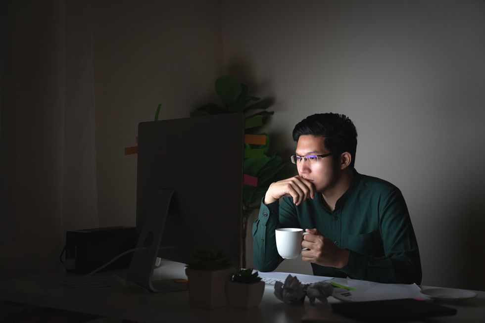 Unemployed man researching Work It Daily's career growth club.