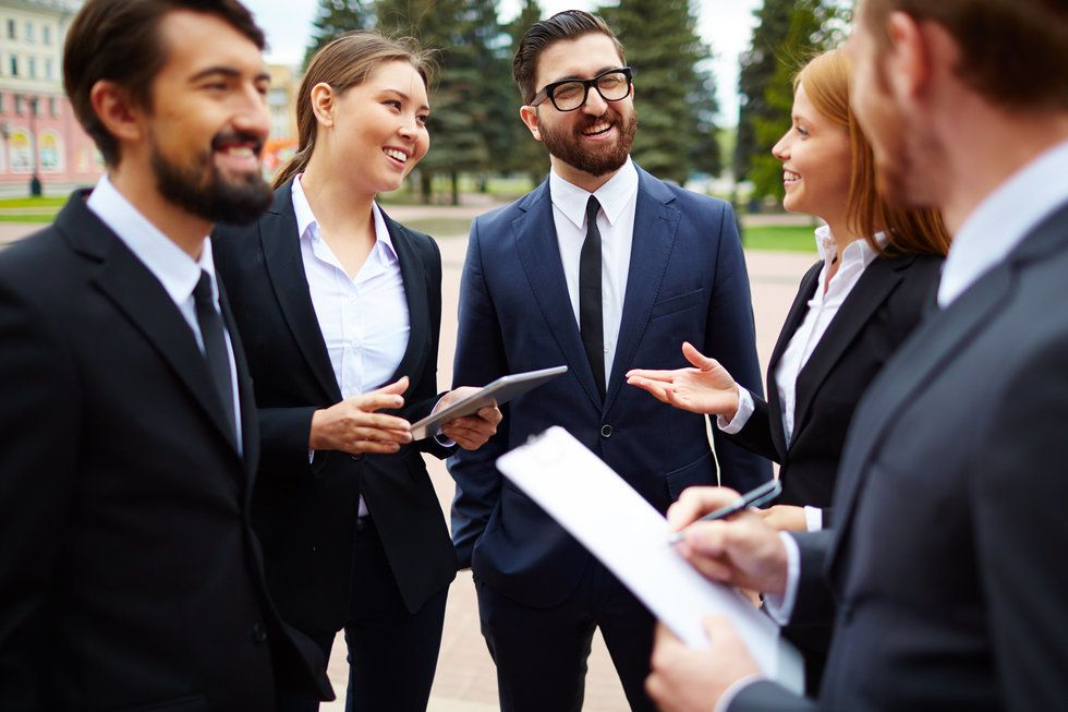 Young professionals networking to stay relevant in the job market
