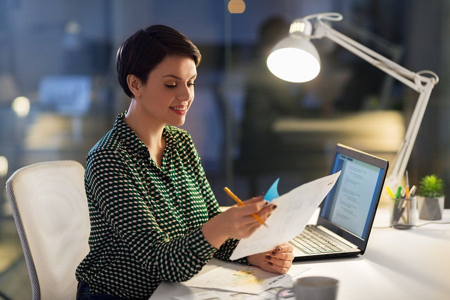 Woman reviewing her resume and tailoring it for a leadership role.
