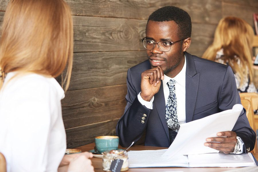 Interviewer ask job candidate if they are a team player