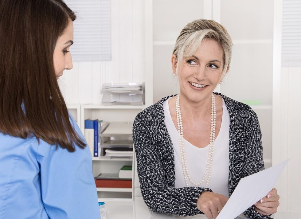 Woman asking job candidate questions about work ethic during interview