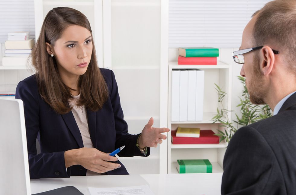 Interviewer asks a job candidate questions to find out if they can take feedback