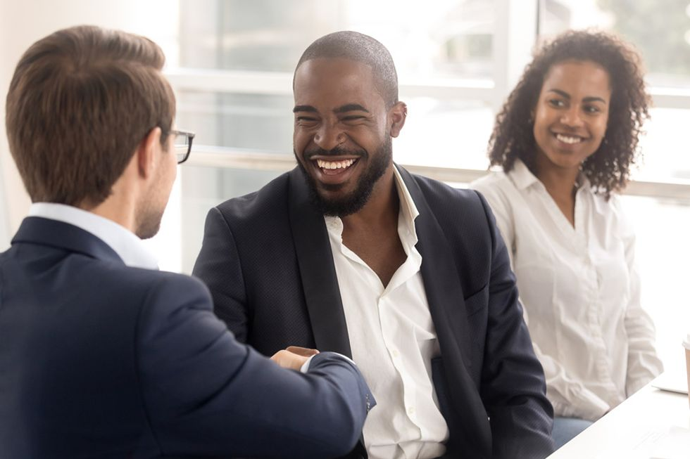 New associate shares a laugh with his boss.