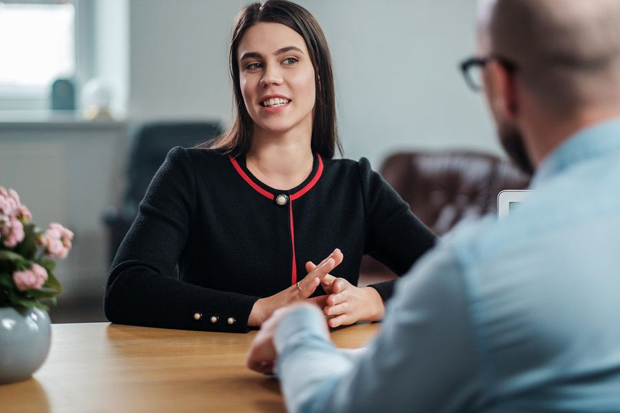 """Job candidate answers the question, """"Why should we hire you?"""" during an interview"""
