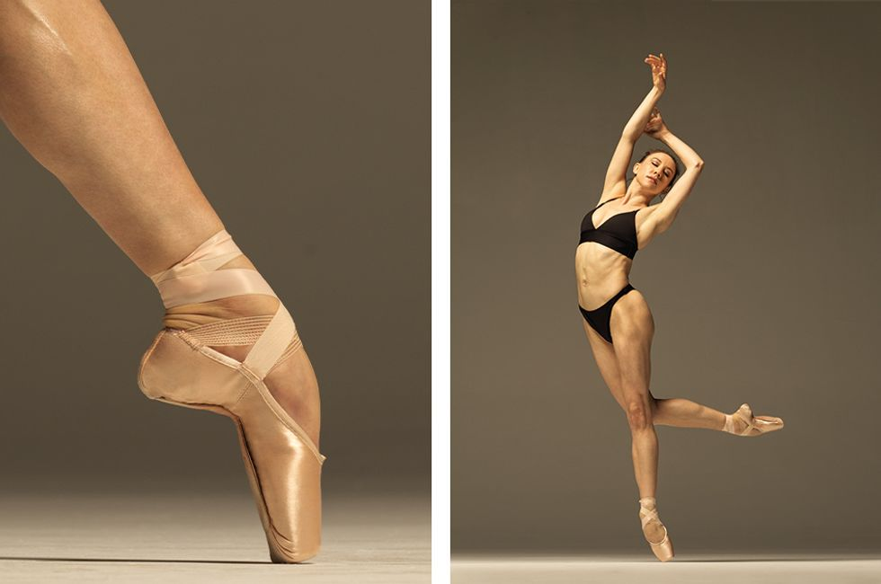 The left side of the image is a foot in pointe shoes, in tend. The right side is Isabella in a black bra and underwear and pointe shoes. She is on pointe on one foot, slightly falling off releve as she leans to the side. Her other leg is behind her, bent at the knee. Her arms are above her, one hand at the other elbow.