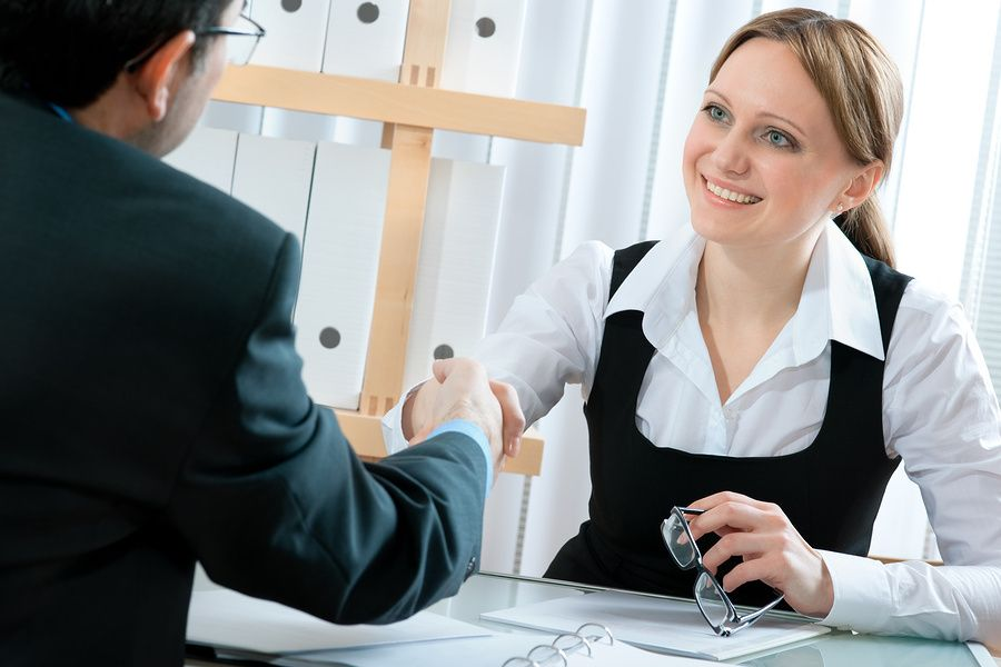 Young woman remains positive during difficult job interview questions.