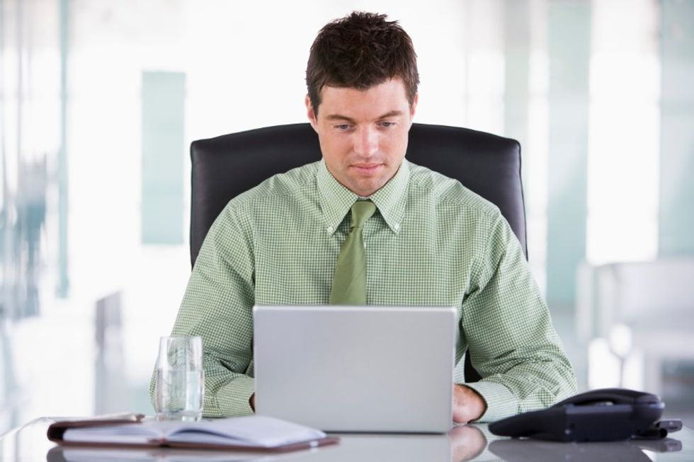 Young business man setting work goals for himself in order to be happier at work.