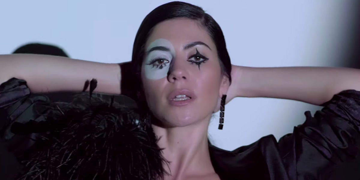 """Marina Is A Sad, Sparkly Jester In New Acoustic Video For """"Karma"""""""