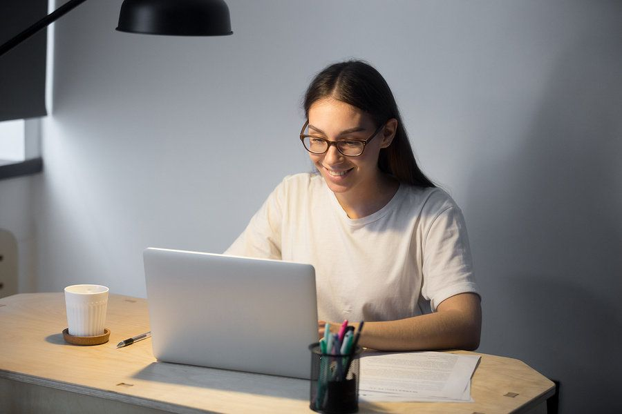Woman referring to notes during her Skype interview