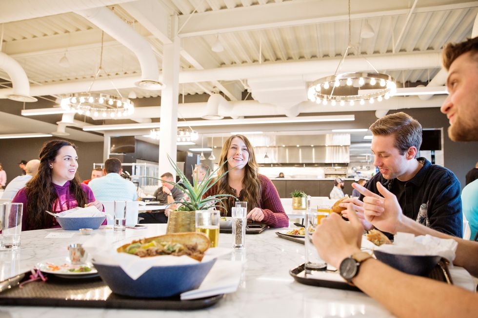 Malouf employees enjoy a healthy lunch in the Malouf kitchen.
