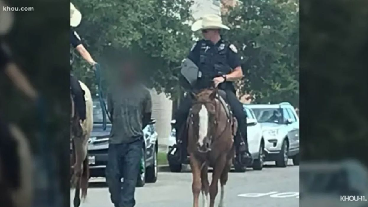 Police release body cam footage of officers on horseback who tied up and led a mentally ill black man down the road: 'This is gonna look really bad'