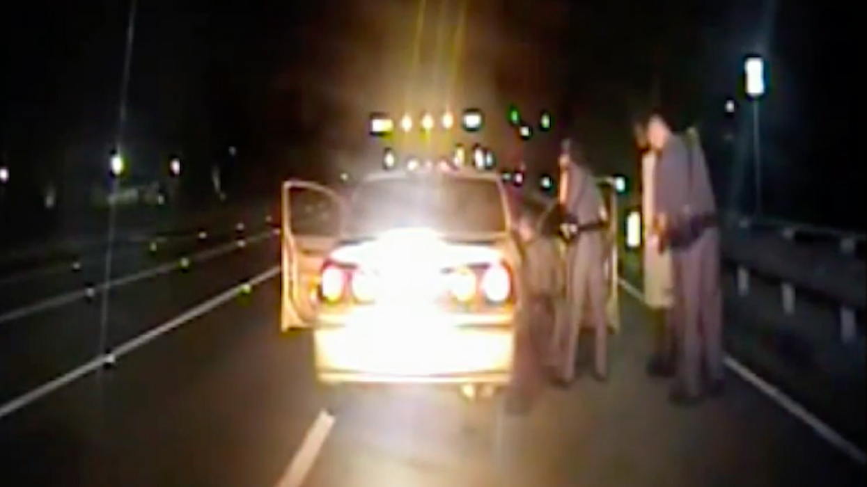 WATCH: Cop pulls over speeding car — then ends up delivering a baby