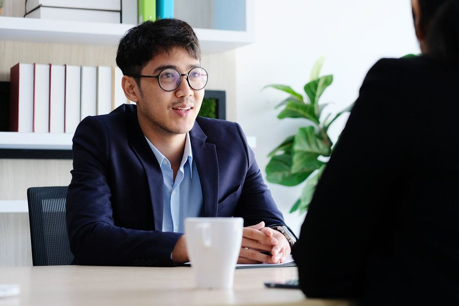 Young job candidate talking about what he can bring to the company during a job interview.