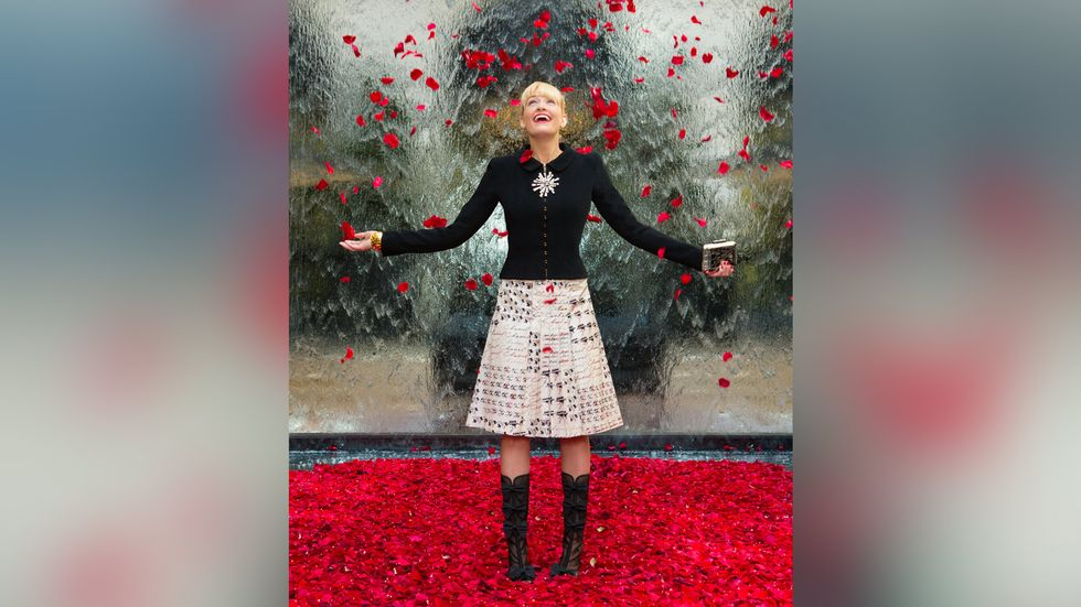 Beth Behrs with rose petals