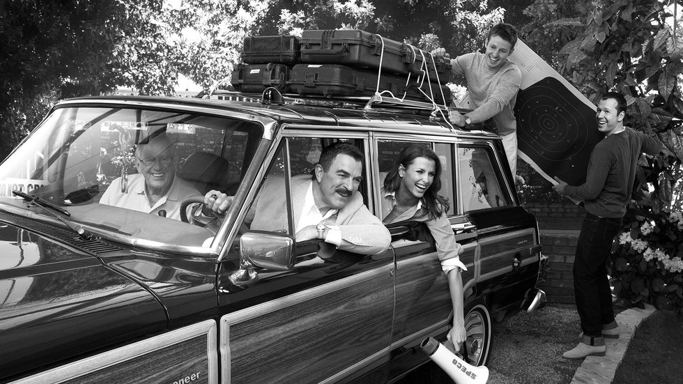 The cast of Blue Bloods loading up a station wagon for a trip
