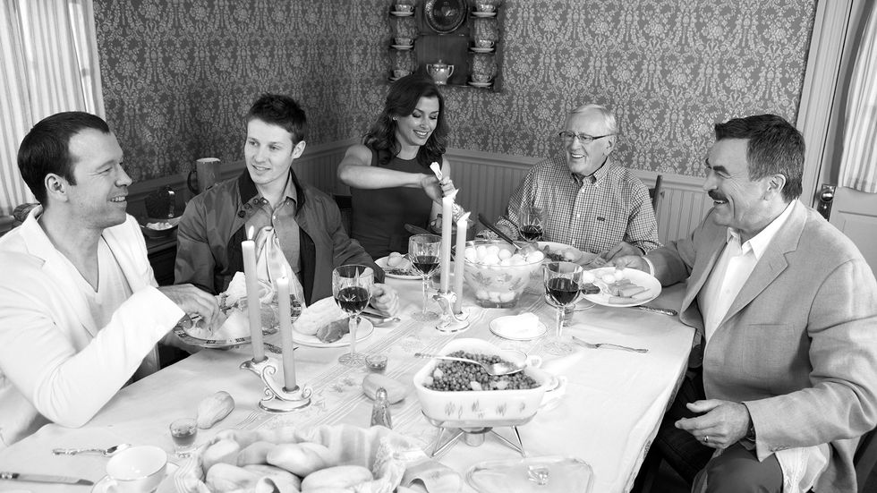 The cast of Blue Bloods sitting around a dinner table
